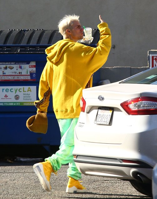 Justin Bieber sporting new yellow shoes on Monday at gym December 9, 2019. (Photo by X17/SIPA Press)