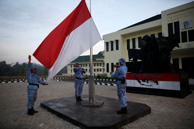 "Participants of the Bela Negara – ""defend the nation"" – programme raise an Indonesian flag at a training centre in Rumpin, Bogor, West Java, Indonesia June 2, 2016. (Photo by Darren Whiteside/Reuters)"