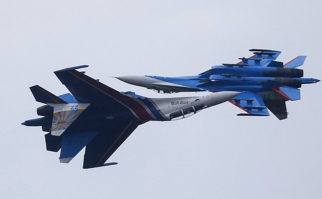 Sukhoi Su-27 Flanker fighters of the Russkiye Vityazi (Russian Knights) aerobatic display team perform during a demonstration flight at an opening ceremony of the International Army Games-2015 in Alabino, outside Moscow, Russia, August 1, 2015. (Photo by Maxim Shemetov/Reuters)