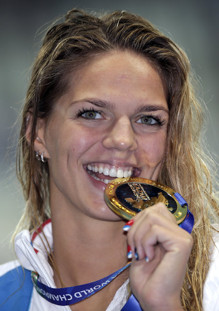 Russia's gold medalist Yuliya Efimova poses after the medal ceremony for the 100m breaststroke final at the Swimming World Championships in Kazan, Russia, Tuesday, August 4, 2015. (Photo by Michael Sohn/AP Photo)