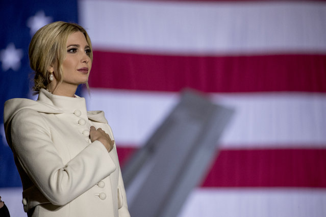 Ivanka Trump, the daughter of President Donald Trump, stands on stage during the playing of the National Anthem before President Donald Trump signs the National Defense Authorization Act for Fiscal Year 2020 at Andrews Air Force Base, Md., Friday, December 20, 2019, before traveling to Mar-a-lago in Palm Beach, Fla. (Photo by Andrew Harnik/AP Photo)