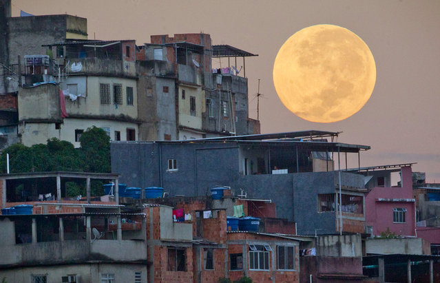 A full moon looms above the Mare shanty town complex in Rio de Janeiro, Brazil, on May 6, 2012