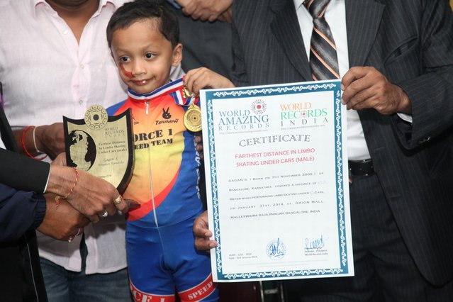 Gagan Satish holding a certificate after performing limbo skating under thirty nine cars in Bengaluru, India. (Photo by Arkaprava Ghosh/Barcroft Media India)