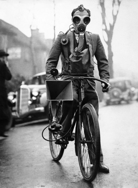 A cyclist complete with respirator, bearing a portable amplifier for warning at Hendon on March 10, 1936. (Photo by AP Photo)