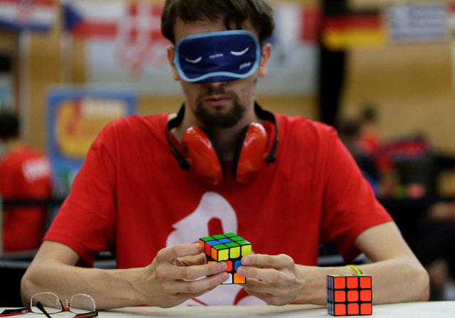 A blindfolded competitor solves a Rubik's cube as he prepares for the Rubik's Cube European Championship in Prague, Czech Republic, July 15, 2016. (Photo by David W. Cerny/Reuters)