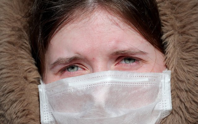 A woman wears a medical face mask near a hospital for infectious diseases in Minsk, Belarus, 28 February 2020. Belarusian authorities have reported the first confirmed case of the COVID-19 disease caused by the novel SARS-CoV-2 coronavirus (which was first discovered in the Chinese city of Wuhan) in the Eastern European country. (Photo by Tatyana Zenkovich/EPA/EFE/Rex Features/Shutterstock)