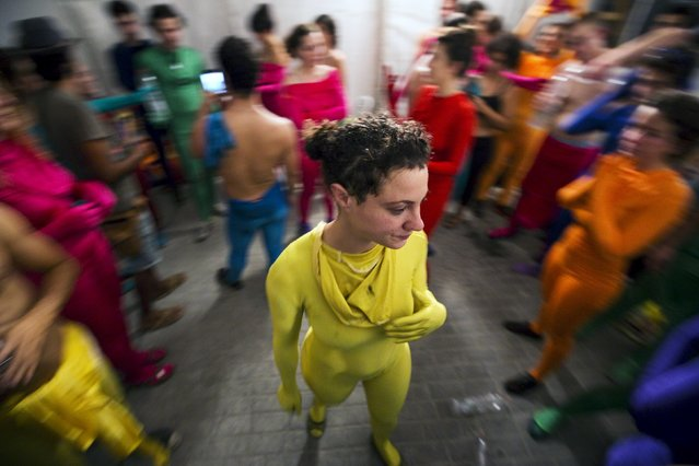 A group of people wearing full solid-coloured bodysuits are seen after taking part in a street art performance in Bat Yam, near Tel Aviv, Israel August 29, 2015. (Photo by Amir Cohen/Reuters)