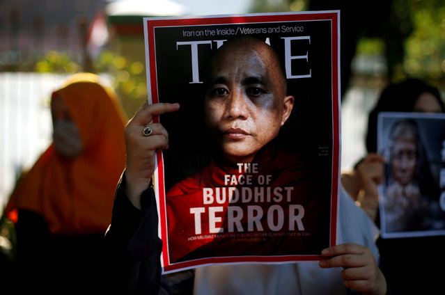 A muslim student holds poster near the Myanmar embassy during a protest against the treatment of the Rohingya Muslim minority by the Myanmar government, in Jakarta, Indonesia September 15, 2017. (Photo by Reuters/Beawiharta)