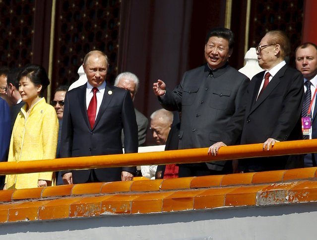 Chinese President Xi Jinping (2nd R) talks to former President Jiang Zemin (R) next to Russia's President Vladimir Putin (2nd L) and South Korea's President Park Geun-hye on the Tiananmen Gate, at the beginning of the military parade marking the 70th anniversary of the end of World War Two, in Beijing, China, September 3, 2015. (Photo by Damir Sagolj/Reuters)