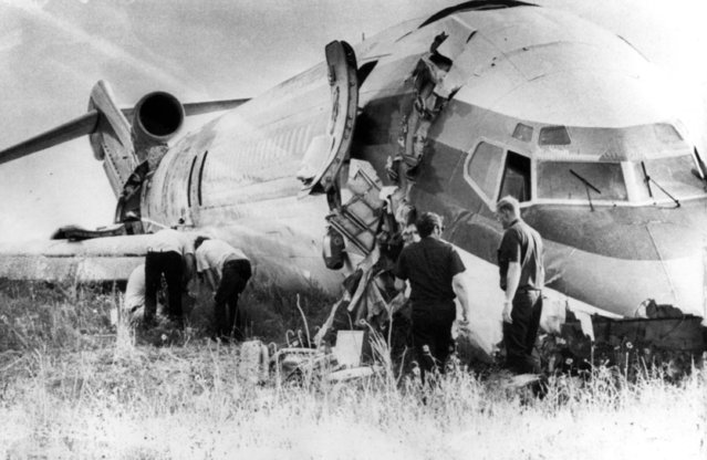 A Continental Airlines 727 crashed on its belly at Stapleton International Airport in Denver, Colorado, August 8, 1975. The crash impact cracked the nose and tail sections of the plane. There were no fatalities from the crash on takeoff. (Photo by AP Photo)