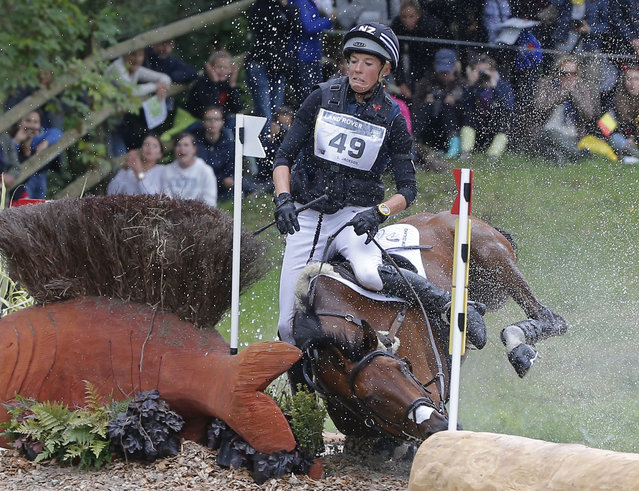Lucy Jackson of New Zealand, riding Willy Do, is unseated during the cross-country test of the Eventing competition at the FEI World Equestrian Games, at the French National Stud, in Le Pin-au-Haras, western France, Saturday, August 30, 2014. (Photo by Michel Euler/AP Photo)