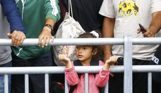 Migrants wait at a railway station in Vienna, Austria September 5, 2015. (Photo by Dominic Ebenbichler/Reuters)
