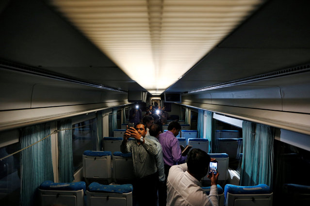 People take pictures inside the high speed Talgo train during its trial run at a railway station in Mumbai, India August 2, 2016. (Photo by Danish Ismail/Reuters)
