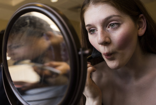 Kaylee Cantler, 15, of Waynesboro, Pa., applies blush during a natural makeup exercise at a modeling camp at the Courtyard Marriott Hotel in McLean, Va., on Monday, August 17th, 2015. (Photo by Brittany Greeson/The Washington Post)