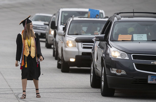 Virginia High Valedictorian Abigail Faith Dalton is the first student to receive her diploma during the graduation ceremony at Bristol Motor Speedway, Friday, May 22, 2020, in Bristol, Tenn. The 2020 Virginia High School class held a special drive-thru graduation at the Bristol Motor Speedway on Friday night, amid the coronavirus pandemic. (Photo by Andre Teague/Bristol Herald Courier via AP Photo)