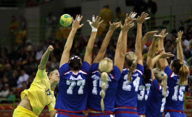 Sweden's Linnea Torstensson, left, takes a free throw during the women's preliminary handball match between Russia and Sweden at the 2016 Summer Olympics in Rio de Janeiro, Brazil, Wednesday, August 10, 2016. (Photo by Ben Curtis/AP Photo)