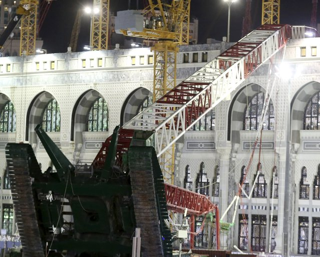 Saudi emergency crew stand near a construction crane after it crashed in the Grand Mosque in the Muslim holy city of Mecca, Saudi Arabia September 11, 2015. At least 107 people were killed when the crane toppled over at Mecca's Grand Mosque on Friday, Saudi Arabia's Civil Defence authority said, less than two weeks before Islam's annual haj pilgrimage. (Photo by Reuters/Stringer)