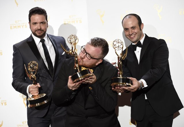 "Josh Earl, from left, Alexander Rubinow and Alex Durham, winners of the award for outstanding picture editing for reality programming for the ""Deadliest Catch"", pose in the press room at the Creative Arts Emmy Awards at the Microsoft Theater on Saturday, September 12, 2015, in Los Angeles. (Photo by Chris Pizzello/Invision/AP Photo)"
