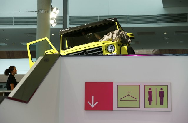 A woman looks at the new Mercedes-Benz G500 4x4 car during the media day at the Frankfurt Motor Show (IAA) in Frankfurt, Germany, September 14, 2015. (Photo by Ralph Orlowski/Reuters)