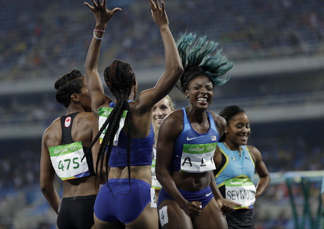Brianna Rollins from the United States, center left, celebrates winning the gold medal in the women's 100-meter hurdles final with second placed United States' Nia Ali, center right, during the athletics competitions of the 2016 Summer Olympics at the Olympic stadium in Rio de Janeiro, Brazil, Wednesday, August 17, 2016. (Photo by David J. Phillip/AP Photo)