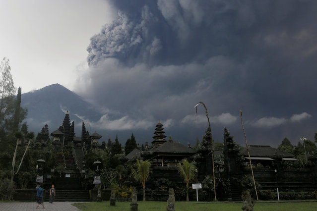 Foreign tourists take pictures as Mount Agung erupts at Besakih Temple in Karangasem, Bali, Indonesia on November 26,  2017. (Photo by Johannes P. Christo/Reuters)