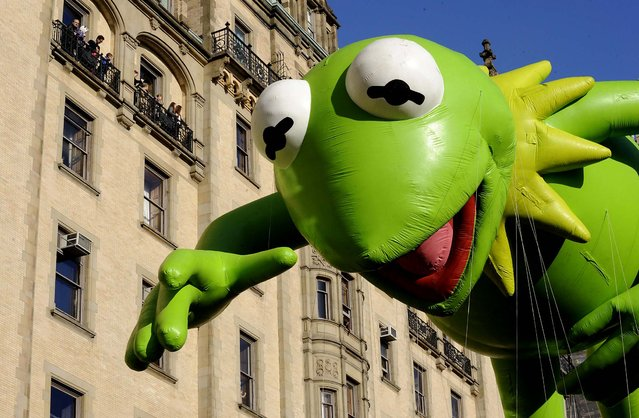 The Kermit The Frog balloon makes its way down New York's Central Park West. (Photo by Louis Lanzano/Associated Press)