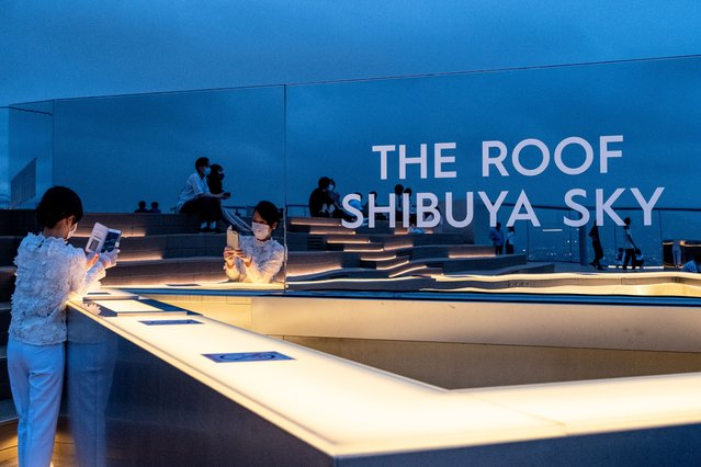 """""""The roof shibuya sky"""" sign seen with people enjoying the sky view during the covid 19 crisis in Tokyo, Japan on June 24, 2020. (Photo by Viola Kam/SOPA Images/LightRocket via Getty Images)"""