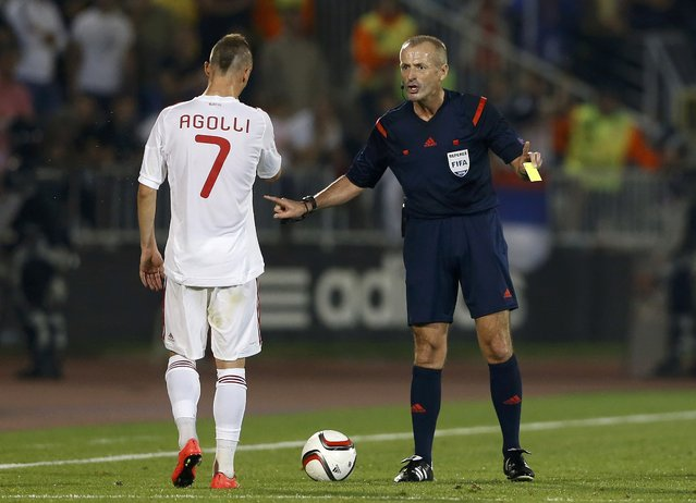 English referee Martin Atkinson (R) speaks to Ansi Agolli of Albania after showing him a yellow card during their Euro 2016 Group I qualifying soccer match against Serbia at the FK Partizan stadium in Belgrade October 14, 2014. (Photo by Marko Djurica/Reuters)