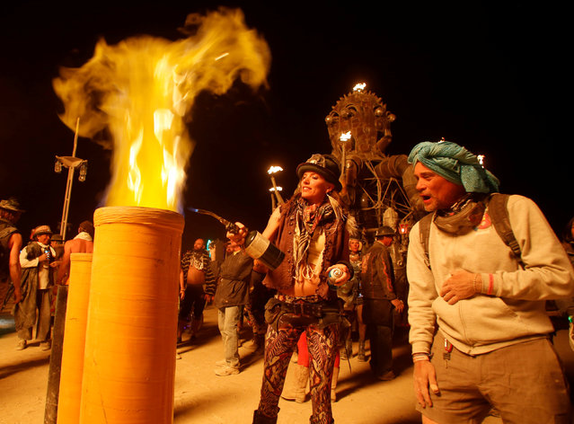 Wrecka, her Playa name, plays with fire as the Man burns as approximately 70,000 people from all over the world gather for the 30th annual Burning Man arts and music festival in the Black Rock Desert of Nevada, U.S. September 3, 2016. (Photo by Jim Urquhart/Reuters)