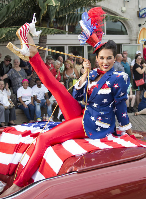 "Miss Connecticut Alyssa Taglia shows her shoe during the 2017 Miss America pageant ""Show Us Your Shoes"" parade Saturday, September 10, 2016, in Atlantic City. (Photo by Chris Szagola/AP Photo)"