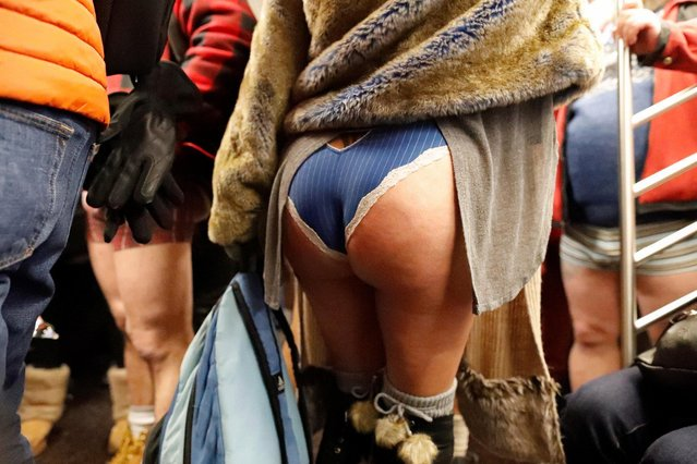 """People participate in the annual """"No Pants Subway Ride"""" in New York City on January 7, 2018. (Photo by Elizabeth Shafiroff/Reuters)"""