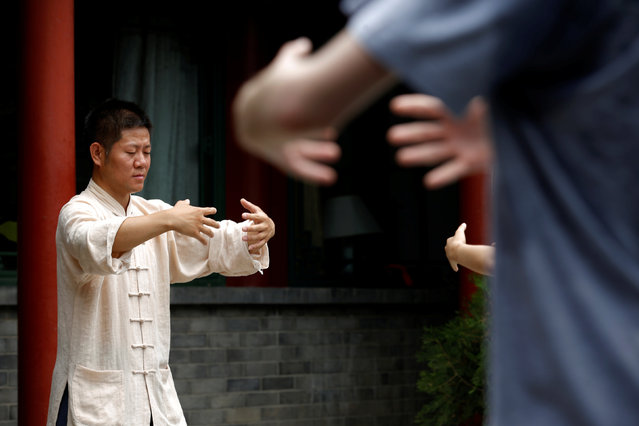 "Kung Fu master Xing Xi teaches his students at his Kung Fu academy ""Kung Fu Zen"" in Beijing, China, July 3, 2016. (Photo by Kim Kyung-Hoon/Reuters)"