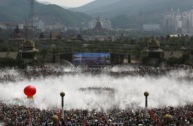 Visitors participate in the annual water-splashing festival in Xishuangbanna, Yunnan province, April 15, 2015. Thousands of people participated in the festival on Tuesday to celebrate the 1,377th ethnic Dai minority New Year, local media reported. (Photo by Reuters/Stringer)