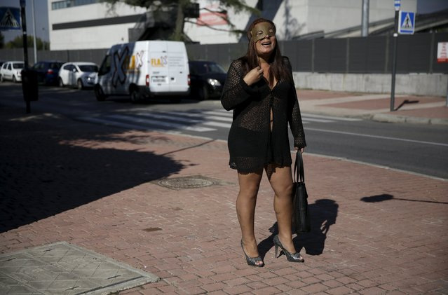 A s*x worker stages a performance to denounce what they say is abuse and social stigma against them in Madrid, Spain, October 14, 2015. (Photo by Andrea Comas/Reuters)