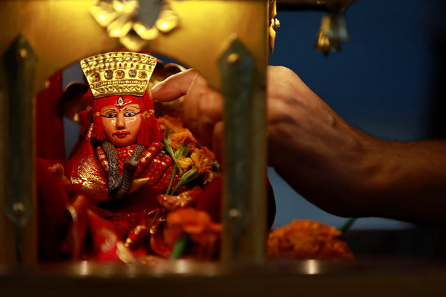 An idol of the Living Goddess Kumari is pictured inside the miniature chariot kept on display during the annual festival of Indra Jatra as the official celebration has been cancelled due to the spread of the coronavirus disease (COVID-19) in Kathmandu, Nepal on September 2, 2020. (Photo by Navesh Chitrakar/Reuters)