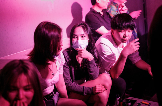 The people drink outside the disco bar on September 18, 2020 in Wuhan, Hubei province, China. As there have been no recorded cases of community transmission in Wuhan since May, life for residents is returning to normal. (Photo by Getty Images)