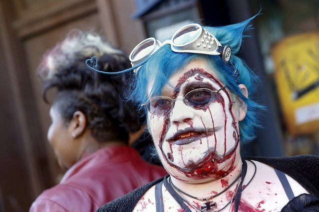 People dressed in costume stand outside a pub during the NYC Zombie Crawl in New York, October 18, 2015. (Photo by Shannon Stapleton/Reuters)