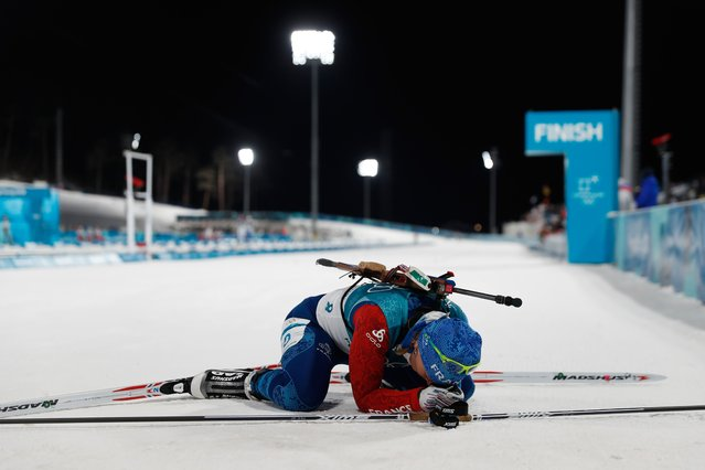France's Anais Bescond reacts after crossing the finish line of the women's 7,5 km sprint biathlon event during the Pyeongchang 2018 Winter Olympic Games on February 10, 2018, in Pyeongchang. (Photo by Odd Andersen/AFP Photo)