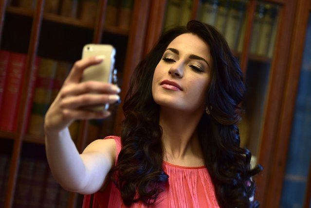 Miss World finalist Julia Gama from Brazil takes a selfie during a publicity launch in central London November 25, 2014. (Photo by Toby Melville/Reuters)