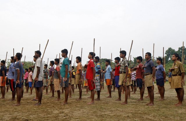 Volunteers of the Hindu nationalist organisation Rashtriya Swayamsevak Sangh (RSS) hold sticks as they pray during a training session at Tatiberia village in West Bengal, India, in this May 20, 2015 file photo. The ascendant Hindu nationalist group, wants minority Muslims and Christians to accept that India is a nation of Hindus, and is pushing some of them to convert. (Photo by Rupak De Chowdhuri/Reuters)