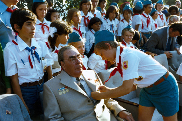 """General Secretary of the Central Committee of the Communist Party of the Soviet Union Leonid Brezhnev in the """"Artek"""" pioneer camp in Gurzuf, 1970s. (Photo by Vladimir Musaelyan)"""
