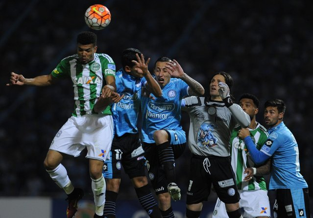 Coritiba's Juninho (L) heads the ball while in action against Belgrano players during their match of the Sudamerican Cup at Mario Alberto Kempes Stadium in Cordoba, Argentina, 28 September 2016. (Photo by Pedro Castillo/EPA)