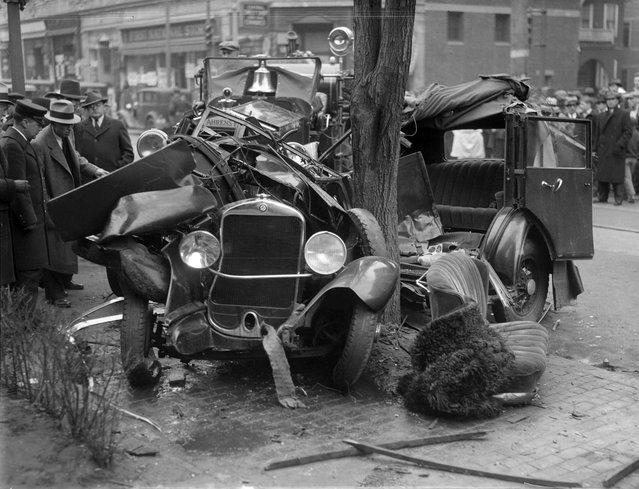 Auto wrapped around tree, 1933. (Photo by Leslie Jones)