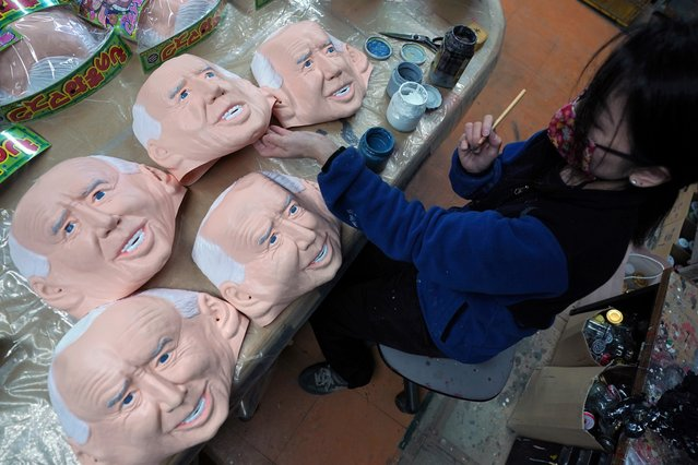 An employee adds details to rubber masks depicting President-elect Joe Biden at the Ogawa Studios in Saitama, north of Tokyo, Wednesday, November 11, 2020. Ogawa Studios, a Japanese manufacturer started making the masks since the middle of October, ahead of last week's election. (Photo by Eugene Hoshiko/AP Photo)