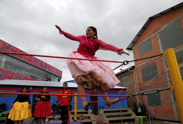 Gloria, a cholita wrestler, fights during their return to the ring after the coronavirus disease (COVID-19) restrictions, in El Alto outskirts of La Paz, December 6, 2020. (Photo by David Mercado/Reuters)