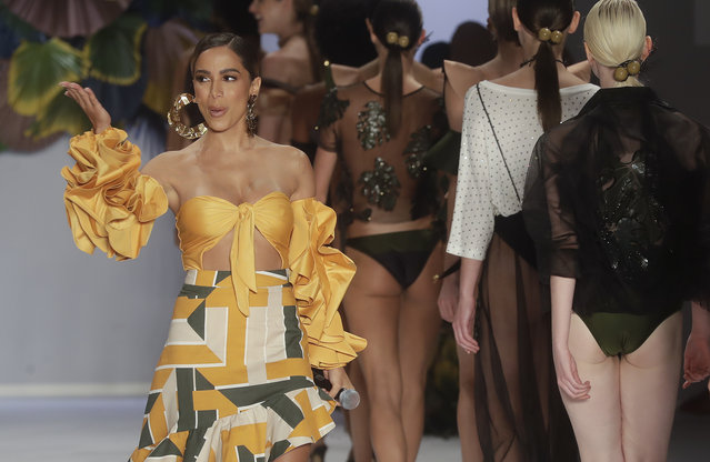 Brazilian singer Anitta performs during the show of the Agua de Coco collection at Sao Paulo Fashion Week in Sao Paulo, Brazil, Saturday, April 21, 2018. (Photo by Andre Penner/AP Photo)