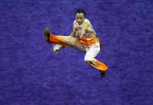 Hongkong's Zheng Tianhui competes in the women's jianshu final during the 13th World Wushu Championship 2015 at Istora Senayan stadium in Jakarta, November 17, 2015. (Photo by Reuters/Beawiharta)