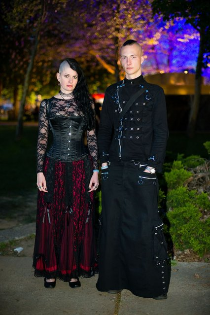 A goth couple poses for pictures at the Agra festival area on the first day of the annual Wave-Gotik Treffen, or Wave and Goth Festival, on May 17, 2013 in Leipzig, Germany. The four-day festival, in which elaborate fashion is a must, brings together over 20,000 Wave, Goth and steam punk enthusiasts from all over the world for concerts, readings, films, a Middle Ages market and workshops. (Photo by Marco Prosch)