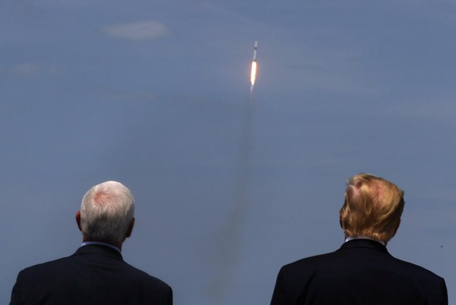 U.S. President Donald Trump and Vice President Mike Pence watch the launch of a SpaceX Falcon 9 rocket and Crew Dragon spacecraft, from Cape Canaveral, Florida, U.S. May 30, 2020. (Photo by Jonathan Ernst/Reuters)