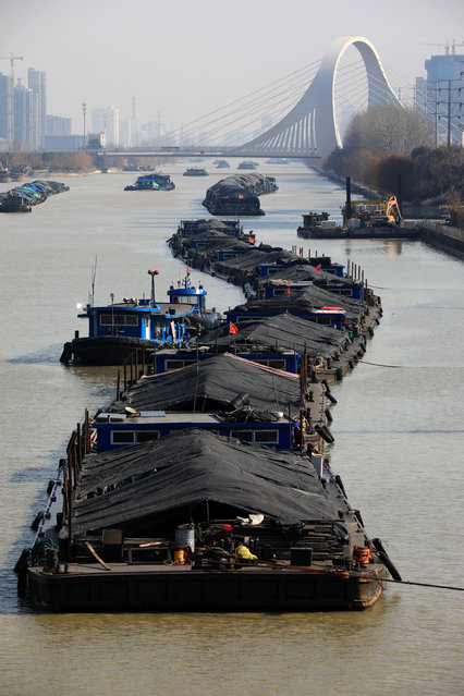 There is an endless stream of ships carrying electric coal along the Beijing-Hangzhou Grand Canal, and the passing docks are full of ships waiting for coal unloading in Huai'an city, east China's Jiangsu Province, 10 January 2021. (Photo by Rex Features/Shutterstock)